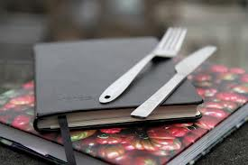 notebook with knife and fork