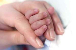 mum and baby hands